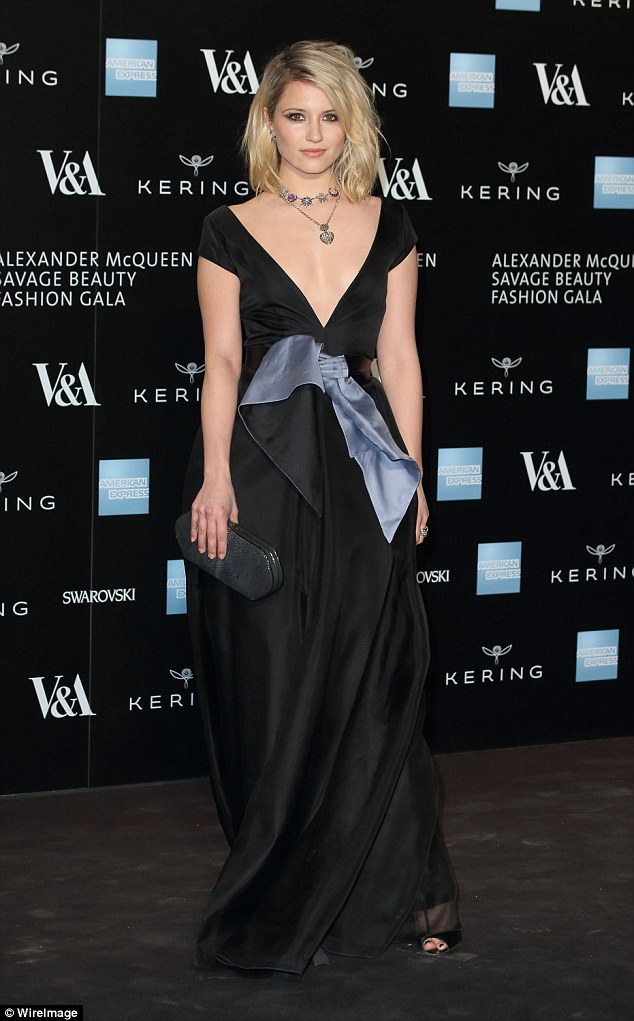Flawless: Despite her wardrobe malfunction, Dianna cut an impeccable figure at the Alexander McQueen: Savage Beauty Fashion Gala in her glorious gown at the V&A Museum