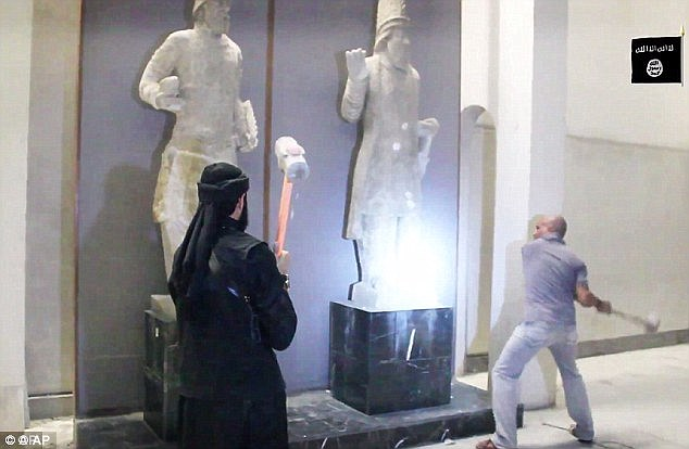 Sick: The terrorist organisation released shocking footage at the end of February purportedly showing jihadis destroying 3,000-year-old artworks with sledgehammers in their northern Iraqi stronghold