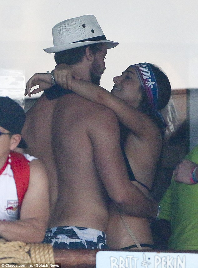 What would Miley say?: Patrick Schwarzenegger was spotted cosying up to a mystery brunette as he partied at the Mango Deck bar in Cabo San Lucas, Mexico on Sunday