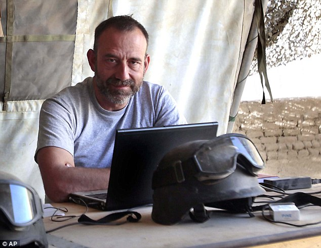 Telling his story: Spanish journalist Marc Marginedas, 46, who was released by ISIS a year ago, says he and 18 other hostages were guarded by three terrorists, who all spoke with British accents