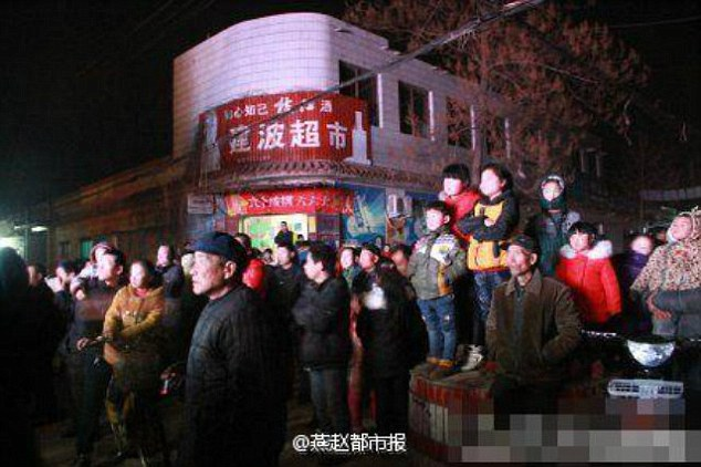A crowd of mourners watching the scandalous performance, which was captured this month after the Spring Festival holiday