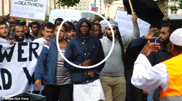 Sinister: Also at the rally wasMichael Adebowale who went on to murder soldier Lee Rigby the following year