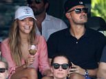 MAVRIXONLINE.COM - WORLDWIDE - Sports Illustrated model Nina Agdal and boyfriend Reid Heidenry are seen at the Miami Open, watching the Andy Murray tennis match, while enjoying a glass of wine. The happy couple appeared to be in great spirits as they enjoyed each others company. At one point Nina adjusts her top as to make sure not to show too much cleavage. Miami, FL. March 27, 2015.<br /> Byline, credit, TV usage, web usage or linkback must read MAVRIXONLINE.COM.<br /> Failure to byline correctly will incur double the agreed fee.<br /> Tel: +1 305 542 9275.