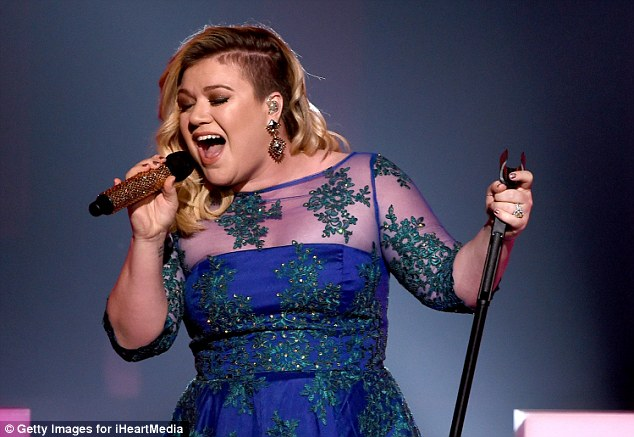 Feeling the love: Kelly Clarkson performed Heartbeat Song at the iHeartRadio Music Awards in Sunday in Los Angeles