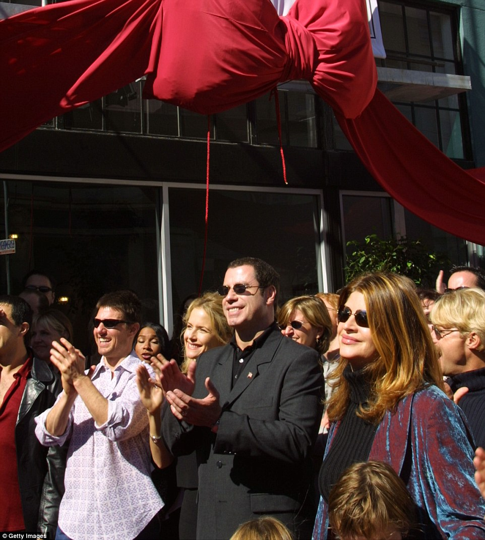 Tom Cruise, Kelly Preston, John Travolta and Kirstie Alley listen to actress Jenna Elfman speak at a Church of Scientology opening