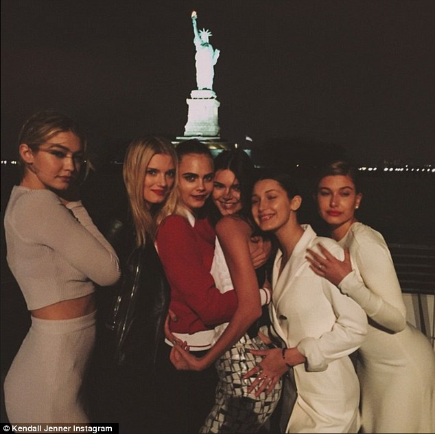 All the models posed in front of the statue of Liberty in New York as the boat passed by