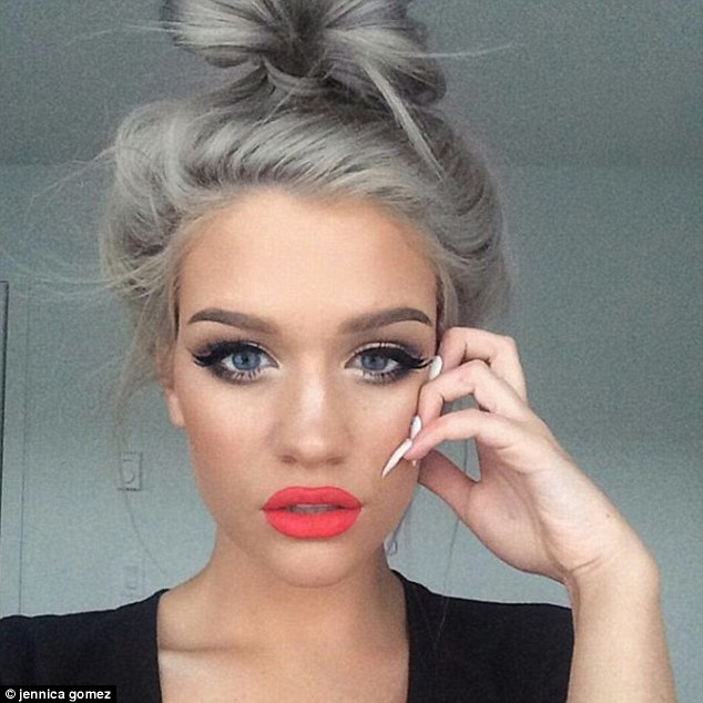 This selfie posted by Jennica Gomez of big lips, white nails and grey hair creates a cool statement