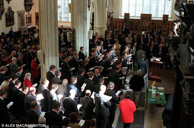 Above, a congregation of Christians in a London church. The data also revealed that the number of atheists and agnostics will decline from 16 per cent of the world's population to 13 per cent in the next four decades