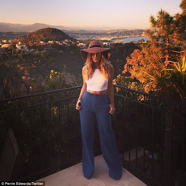 What a view: Little Mix singer Perrie Edwards posed for a picture on the balcony of her hilltop retreat on Thursday, where she is holidaying with Zayn Malik and his family
