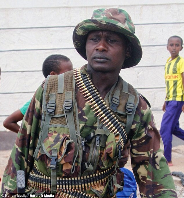 A Kenya Defence Forces soldier carries a machine gun outside Garissa University College on April 2 2015