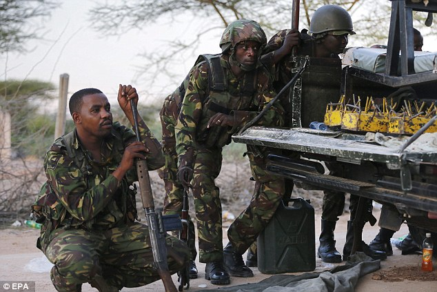 Kenyan soldiers took cover as heavy gunfire continued at Garissa University College in Kenya yesterday