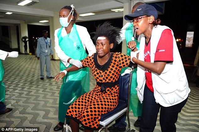 Treatment:Paramedics attend to an injured Kenyan student as she is wheeled into Kenyatta National Hospital in Nairobi
