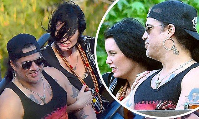 Slash Takes New Girlfriend Meegan And Sons To Disneyland