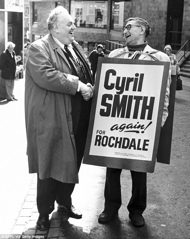 Cyril Smith, pictured campaigning with a sandwich board man, abused an 11-year-old boy at the Liberal Club