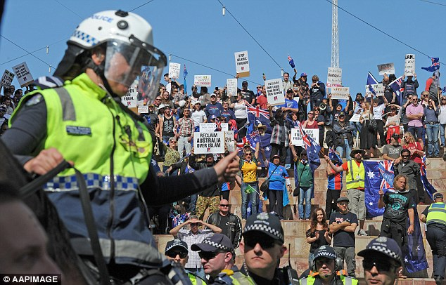 Melbourne police formed a barrier between the separate rallies to attempt to disperse the protesters