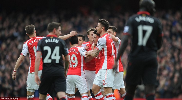 Liverpool's players head back up to the half-way line to resume play after Bellerin's superb strike, but they were soon to be two goals down