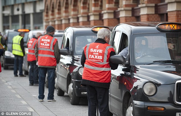Rules laid down by Transport for London (TfL) mean refugees and those applying for asylum do not have to reveal whether their criminal history when trying to become a cab driver (file picture)