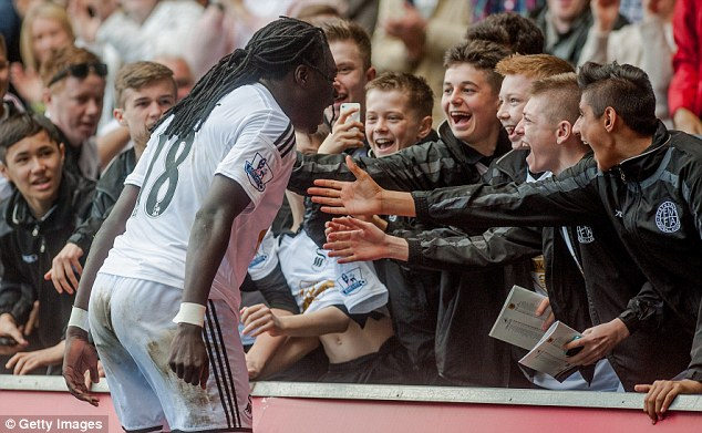 The Swansea striker celebrates with young fans and tops this week's EA Sports' Performance Indez
