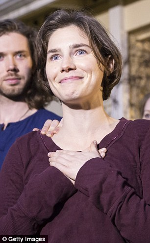 Amanda Knox has vowed to return to Italy just two days after being cleared of murdering British student Meredith Kercher while living in the country