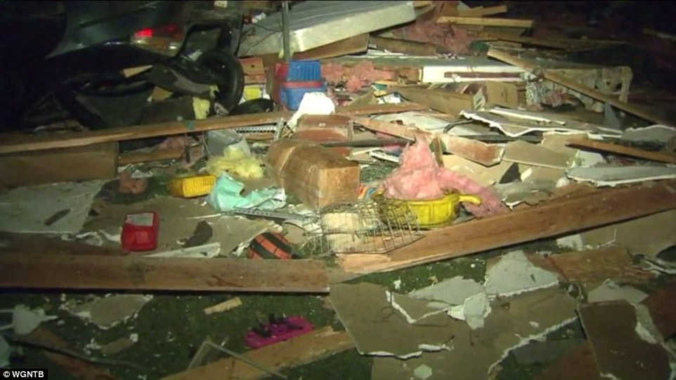 A heap of building materials and household items is seen in Rochelle, Illinois, after the storm