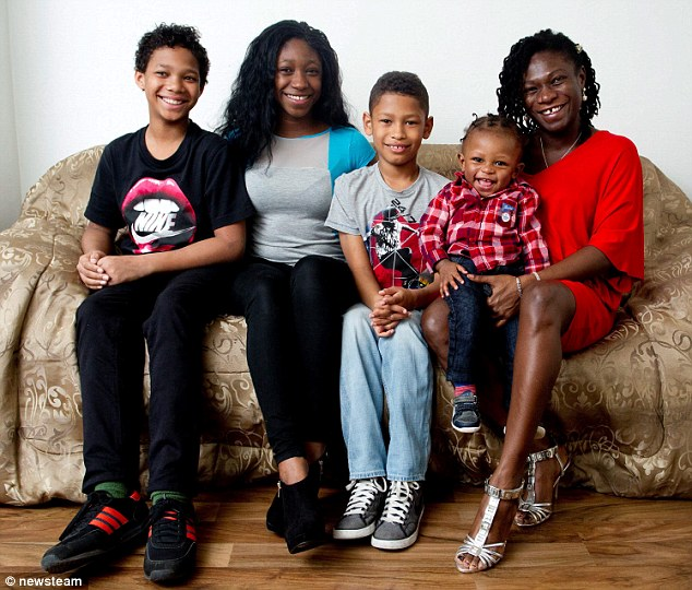 Set to become seven siblings: Nadine Crooks who is expecting triplets pictured with her four children, from left, Trae (13), Roxanne (18), Zion (9) and Joshua (1)