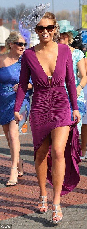 Dressed to the nines: A trio of racegoers show off their style nous as they arrive for a day out at Aintree