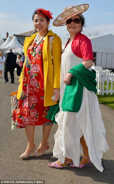 Colourful: Many of the racegoers arriving for Ladies' Day had plumped for bold brights - red was among the favourites
