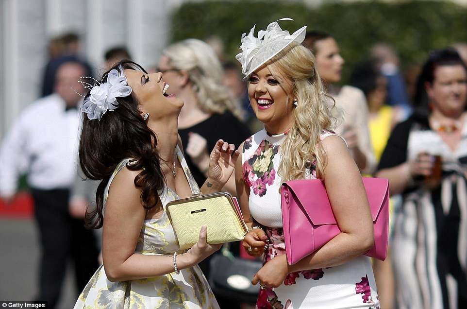Having a laugh: A pair of ladies dissolve into fits of laughter as they enjoy their day in the sunshine at Aintree