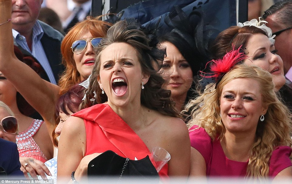 Go on! A lady roars her horse home to victory during the second race of Ladies' Day at Aintree