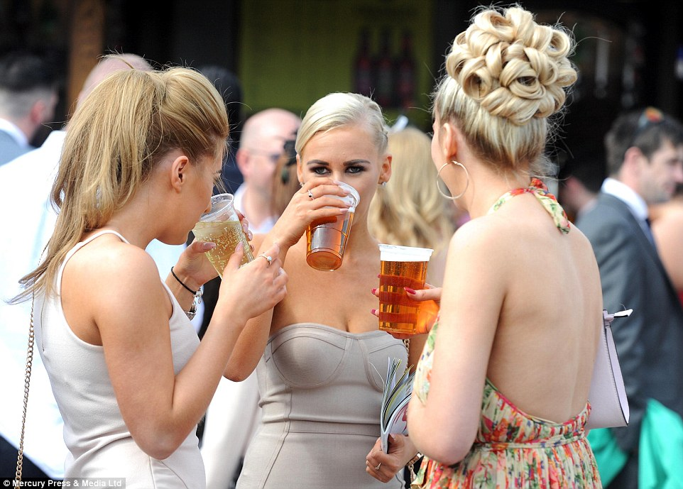 Afternoon pint: Some of the ladies looked content to ignore the racing and got stuck into the beer instead