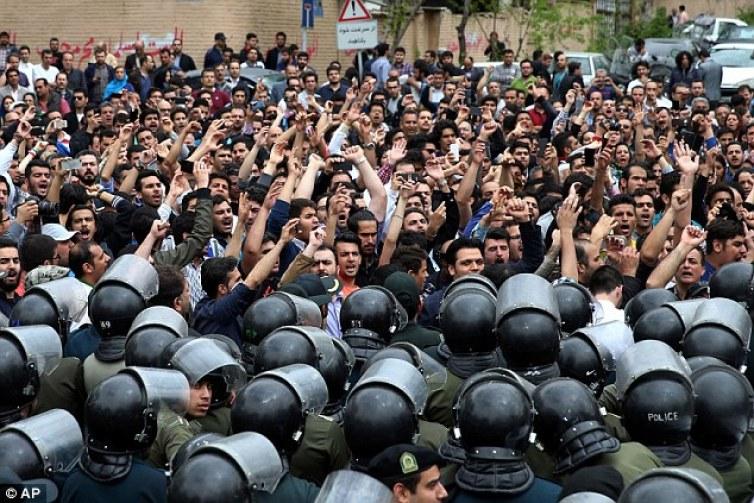 Iranian protesters demonstrate against Saudi-led strikes in Yemen outside the Saudi Arabian Embassy in Tehran