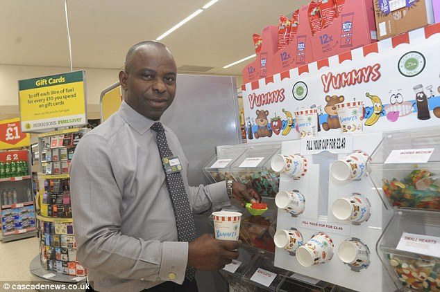 Tolu Oshinowo, Deputy Store Manager, at Morrisons, Blackburn enjoys some of the 36 sweets on offer