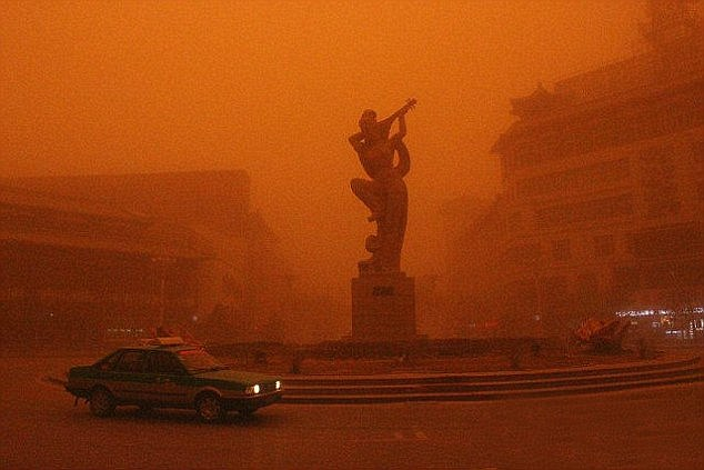 Golmud was left covered in a remarkable red haze when the sand cloud blew across the city