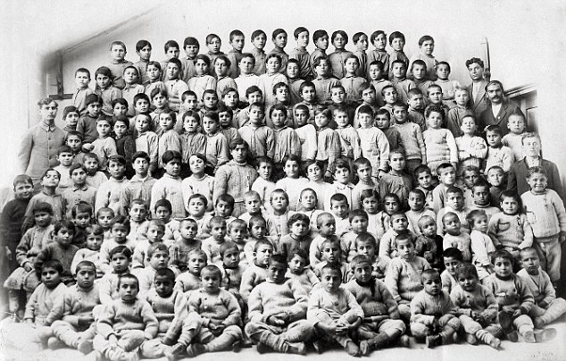 Children, whose parents had been killed for their ethnicity and religion in the brutal genocide here pictured together in 1918