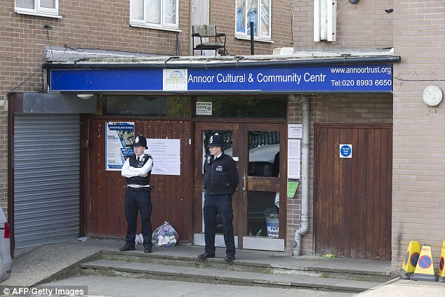 Mosque: Police standing outside the An-Noor cultural centre, where Rashad is a director, in Acton last week