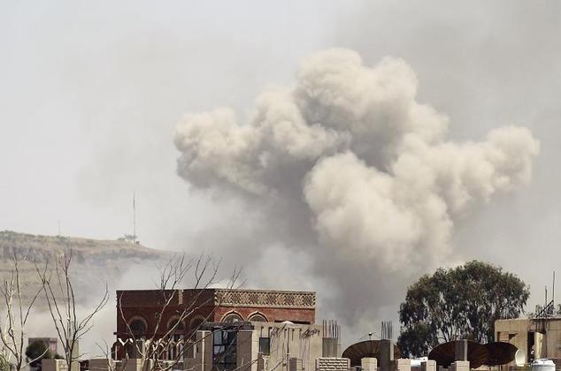 Smoke rises above the Alhva camp, east of the Yemeni capital, Sanaa, on April 17, 2015, following an alleged air strike by the Saudi-led alliance on Shiite H...