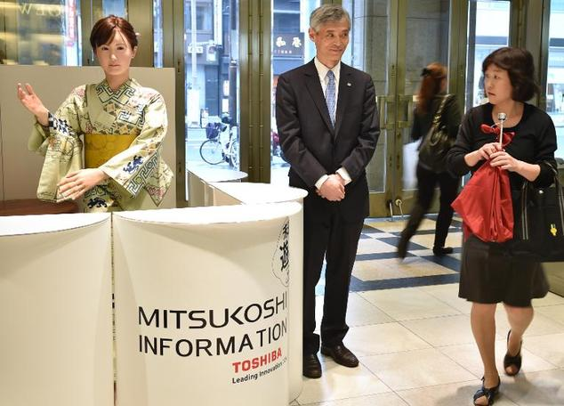 Humanoid ChihiraAico, clad in a Japanese kimono, greets a customer at an entrance of a department store in Tokyo, on April 20, 2015