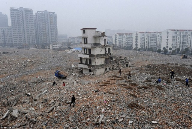 Here comes rubble: A partially demolished nail house at a construction site in Hefei, Anhui province