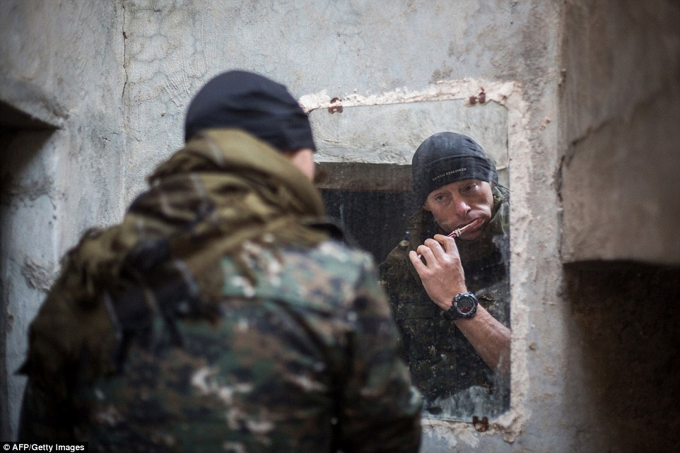 A 33-year old fighter from New Zealand, nick-named Hewal Welat by his Kurdish colleagues, brushes his teeth at a makeshift base camp