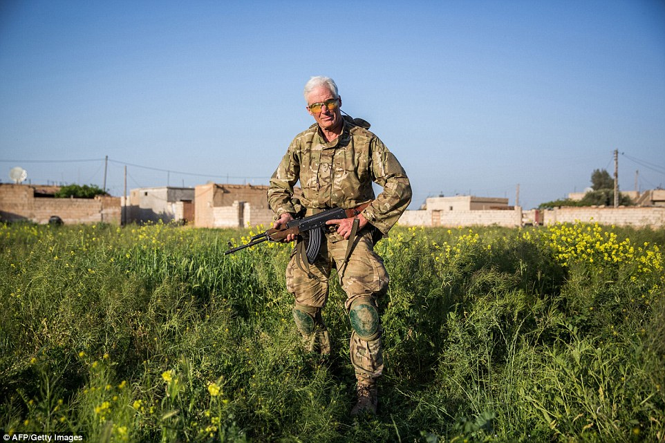 Experience: Despite being 67, Heval Zinar appears incredibly fit and as he stands in full combat gear with an assault rifle in his hands, it is clear the Canadian national boasts the kind of physique a man a third of his age would be proud of
