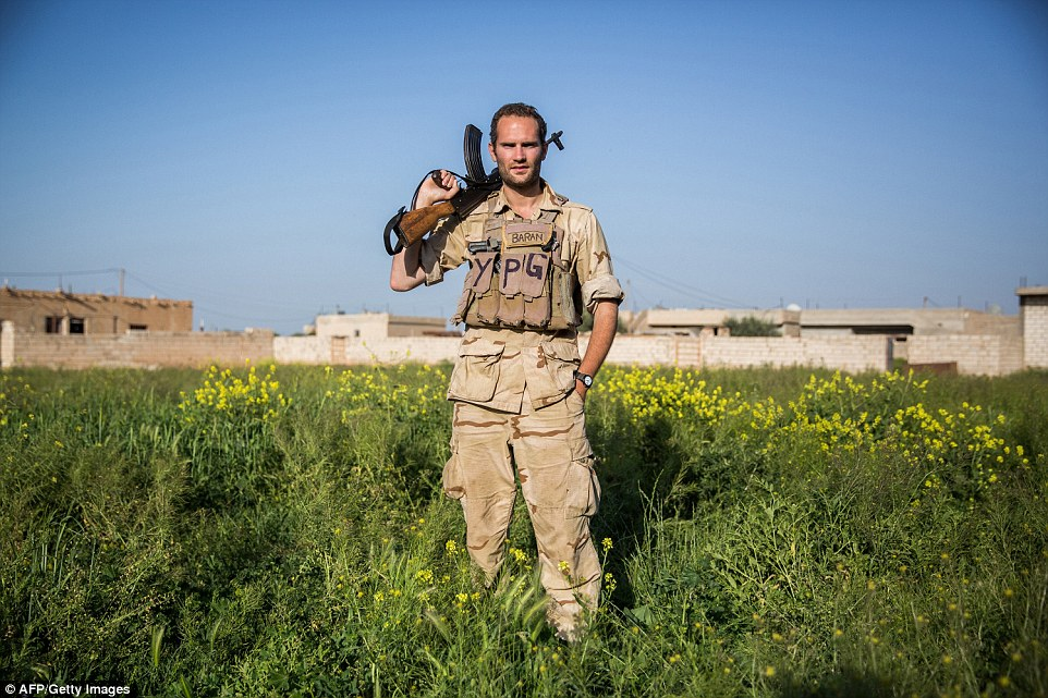 A 28-year old foreign fighter from the UK - nick-named  Hewal Baran by Kurdish fighters but also known as Baran Macer - poses for a photo
