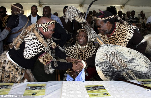 Bankrupt: But the King (centre) ran out of money last year following a particularly expensive few months, and had to beg for more funds - which the government, led by fellow Zulu Jacob Zuma (left), approved