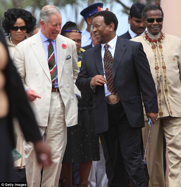 Followers: But despite the extravagances, the King - pictured with Prince Charles in 2011 - is still adored by millions of people, many impoverished, willing to follow his every instruction