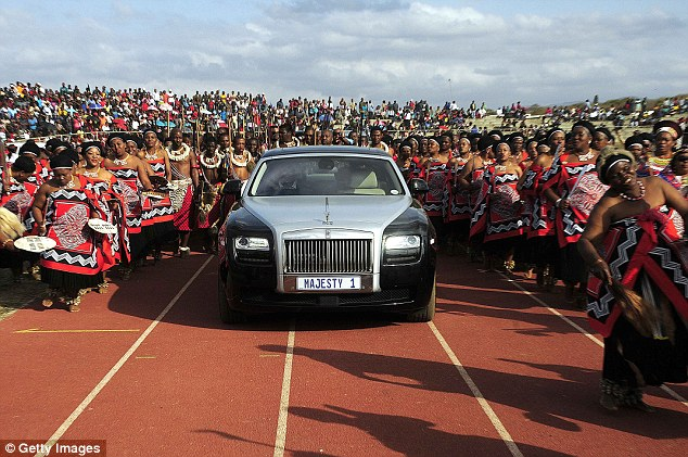 Obscene: Zola Mafu arrives at the Ondini Sports Complex in Ulundi in a Rolls Royce for her wedding to King Zwelithini in July. She became his sixth wife at the lavish ceremony