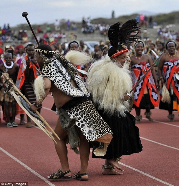 Joy: The new King and Queen celebrate during their wedding, yet Zwelithini is a man who likes to spend more on his birthday cake than many of his subjects earn in a lifetime