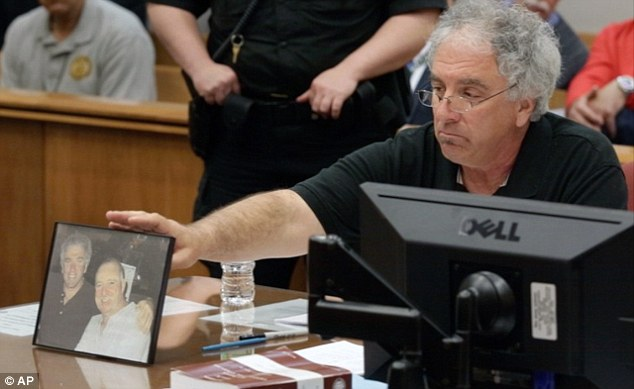 Grief: Raymond Wantorcik, brother of murder victim Danny Burroughs, refers to a photo of the pair stating 'This is my best friend... I won't smile like that anymore' during the sentencing of Loretta Burroughs