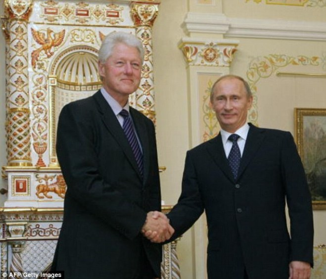 Former president Bill Clinton (left) received $500,000 for a Moscow speaking engagement with Renaissance Capital. He also met Vladimir Putin (right), at the time Russia's prime minister, during the visit