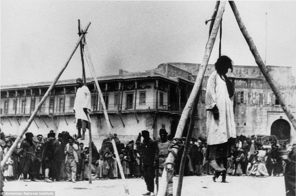 A crowd looks on as Armenians are hanged in the street in Constantinople before their forced removal to the desert had begun after April 1915