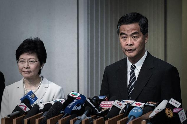 Hong Kong Chief Executive Leung Chun-ying (R) speaks at a press conference next to Chief Secretary Carrie Lam in Hong Kong on April 22, 2015