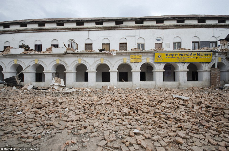 Debris: The school is now surrounded by bricks shaken from the building in the quake